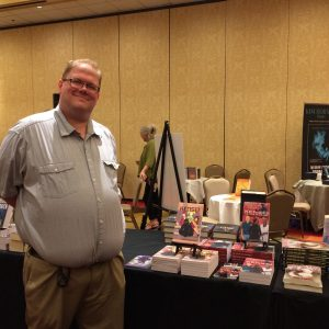 Co-editor Jeremy standing by his Kensei books (from DefCon One) at the PNWA Autograph Party!