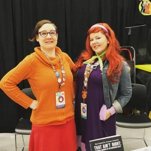 Dawn Vogel and Amanda Cherry cosplaying it up for our table at GeekGirlCon 2017.