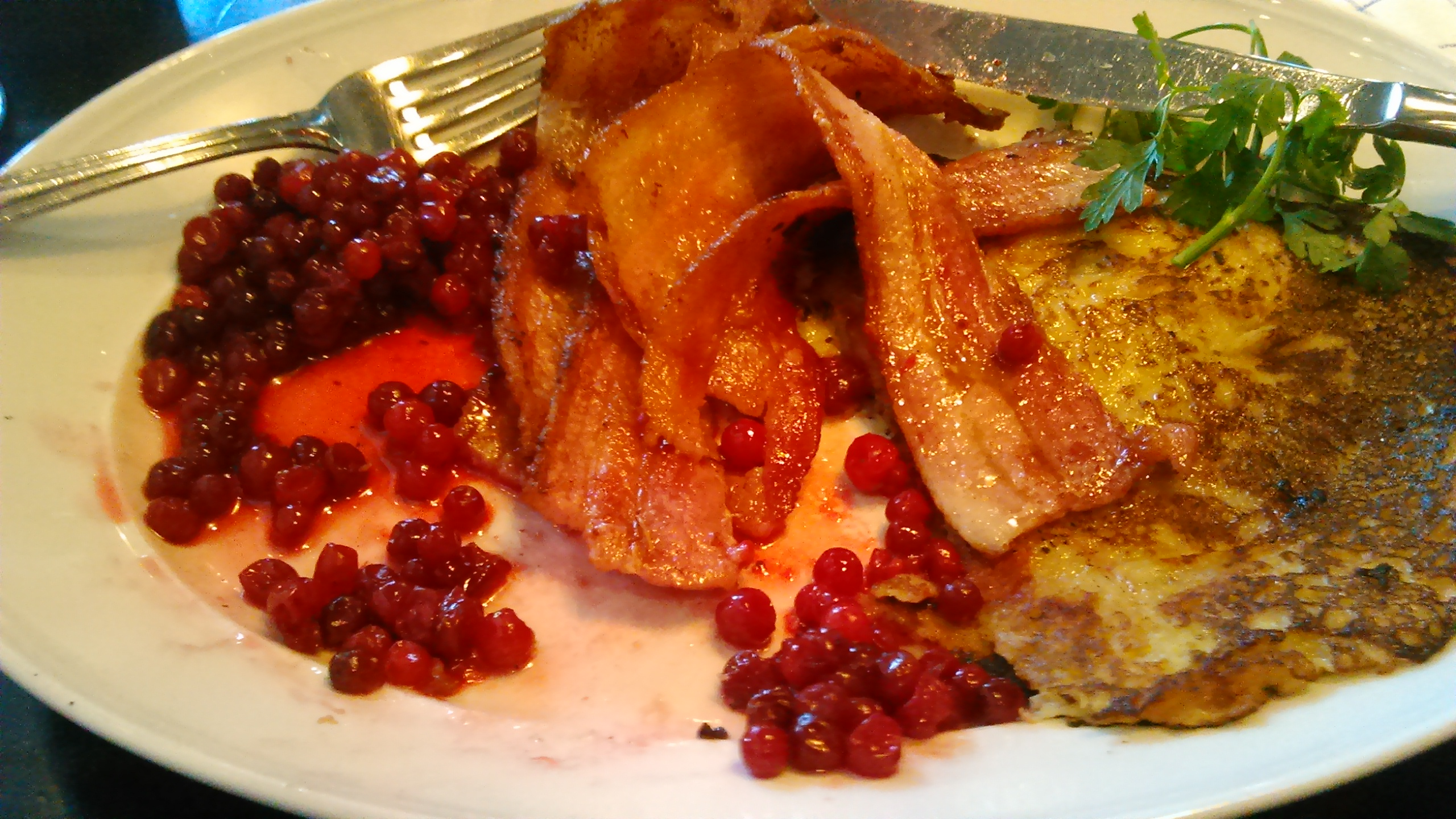 Potato pancakes with lingonberries and bacon
