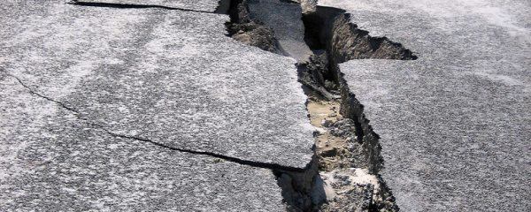Large crack in road surface caused by earthquake