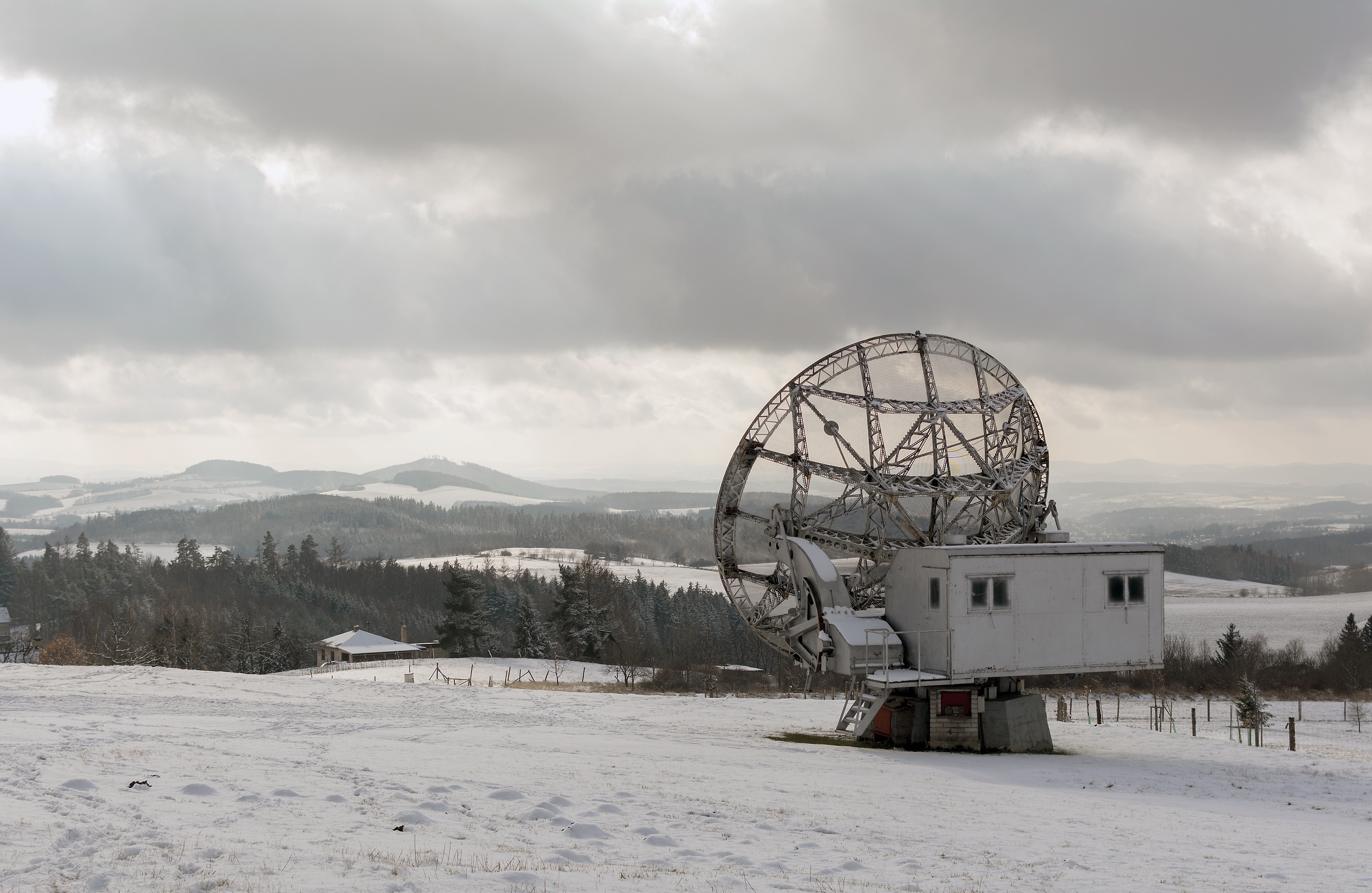 Snowy scene with a parabolic antenna