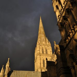 Salisbury Cathedral spire under stormclouds